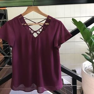 Short sleeve cage neck top